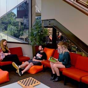 Students sitting on couches in Fairfield campus foyer