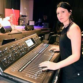 Person standing at a live mixing desk