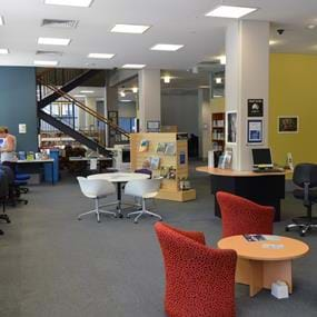 Work stations and meeting tables inside Melbourne Polytechnic's Prahan library